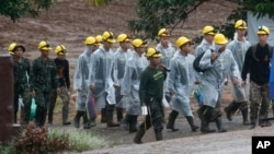 Rescuers walk toward the entrance to a cave complex in Mae Sai, Chiang Rai province, northern Thailand Tuesday, July 10, 2018. Eight boys have been rescued from the flooded cave. (AP Photo/Sakchai Lalit)