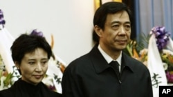 China's former Chongqing Municipality Communist Party Secretary Bo Xilai (R) and his wife Gu Kailai stand at a mourning held for his father Bo Yibo, former vice-chairman of the Central Advisory Commission of the Communist Party of China, in Beijing in thi