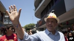 Luis Guillermo Solis, presidential candidate of the Citizen's Action Party waves during a campaign rally in San Jose, Costa Rica, Friday, April 4, 2014.
