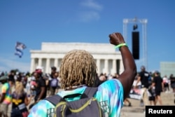 "Demonstrators gather in front of the Lincoln Memorial for the ""Get Your Knee Off Our Necks"" march in support of racial justice that is expected to gather protestors from all over the country in Washington, U.S., August 28, 2020. REUTERS/Erin Scott"