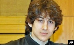 FILE - Dzhokhar Tsarnaev, shown in an undated photo, faces 30 counts in his federal death penalty trial.