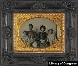 Rare photo of unidentified African American soldier in US Civil War Union uniform with wife and two daughters between 1863 and 1865. (Library of Congress)