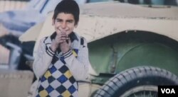 Shagofa Alikozay's award-winning photograph of an 8-year-old boy named Pardes was taken during a break in his work washing cars on the streets of Kabul, shown in this image taken from video.