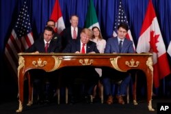 FILE - President Donald Trump, Canada's Prime Minister Justin Trudeau, right, and Mexico's then-President Enrique Pena Nieto, left, participate in the USMCA signing ceremony, Nov. 30, 2018, in Buenos Aires, Argentina.