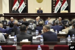Iraqi Prime Minister Haider al-Abadi, center, attends a session of the Iraqi Parliament, in Baghdad, Iraq, Wednesday, Sept. 27, 2017.