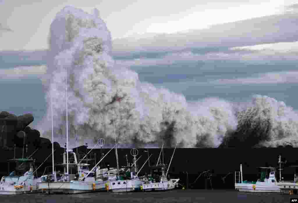 High waves batter a breakwater at a port at Kihou town in Mie prefecture, central Japan. Strong typhoon Phanfone slammed into Japan, packing gusts of wind and huge waves that have already swept three U.S. military officials out to sea, as it made a beeline for Tokyo.