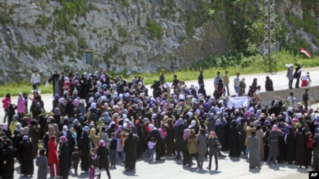 Women demonstrate on the Baida coastal highway to demand to release of those swept up in mass arrests, April 13, 2011