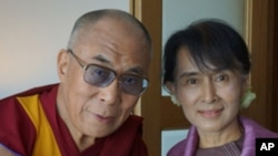 His Holiness the Dalai Lama with Aung San Suu Kyi in London, England, on June 19, 2012.