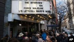 "Patrons wait in line to see ""The Interview"" at the Cinema Village movie theater, Dec. 25, 2014, in New York."