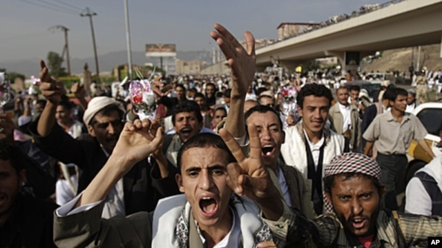 Protesters shout slogans during a demonstration demanding the resignation of Yemen's President Ali Abdullah Saleh, in Sana'a, August, 2011