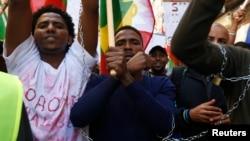 Ethiopian migrants, all members of the Oromo community of Ethiopia living in Malta, protest in Valletta against the Ethiopian regime's plan to evict Oromo farmers to expand Ethiopia's capital, Addis Ababa, Dec. 21, 2015.