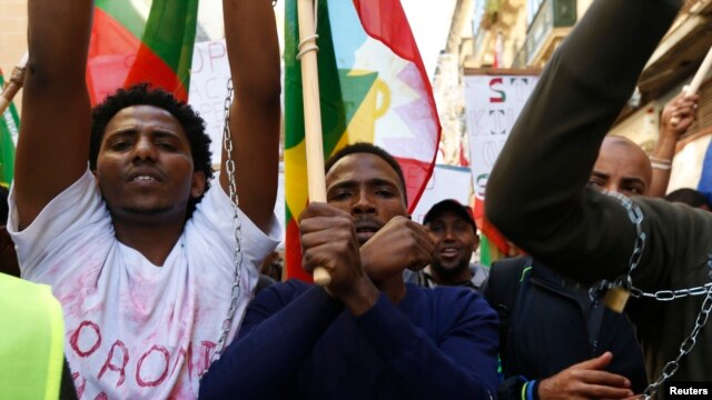 FILE - Ethiopian migrants, all members of the Oromo community of Ethiopia living in Malta, protest in Valletta against the Ethiopian regime's plan to evict Oromo farmers to expand Ethiopia's capital, Addis Ababa, Dec. 21, 2015.