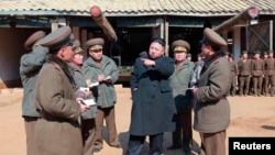 North Korean leader Kim Jong-Un visits a long-range artillery sub-unit. (March 11, 2013)