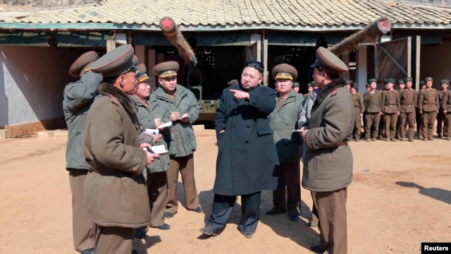 North Korean leader Kim Jong-Un (C) visits a long-range artillery sub-unit of the Korean People's Army Unit 641, March 11, 2013, in this picture released by the North's official KCNA news agency in Pyongyang, March 12, 2013.