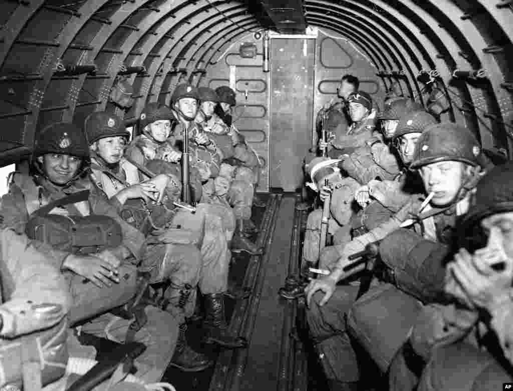 American Paratroopers fly over the English Channel enroute to play a key role in the invasion of France, June 6, 1944, by landing along a 100 mile front of the Normandy coast. (AP Photo/U.S. SIgnal Corps, Handout)