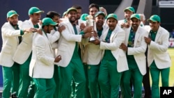 Pakistan players celebrate during the award ceremony for the ICC Champions Trophy at The Oval in London, Sunday, June 18, 2017. Pakistan won the final by crushing India for 180 runs.
