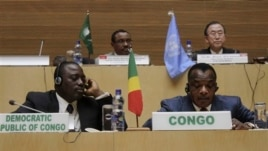 Front row, left to right,  Joseph Kabila Kabange  President of the Democratic Republic of Congo, and Denis Sanssou N'guesso, President of the Republic of Congo, during the signing of the Congo peace deal in Addis Ababa, Ethiopia, Sunday, Feb. 24, 2013. Eleven African countries have signed a United Nations-drafted peace deal to stabilize the troubled Central African country of Congo, where rebels allegedly backed by neighbouring countries last year threatened to oust the government.  Opening the signing ceremony in Ethiopia on Sunday, U.N. Secretary-General Ban Ki-moon said the peace, security and co-operation framework for Congo would bring stability to the region. In the background are Ethiopian Prime Minister Haile Mariam Desalegne, left and United General Secretary Ban Ki- moon.  (AP Photo/ Elias Asmare)