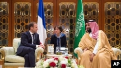 In this Nov. 9, 2017, photo released by Saudi Press Agency, SPA, Saudi Crown Prince Mohammed bin Salman, right, meets with French President Emmanuel Macron upon his arrival in Riyadh, Saudi Arabia.
