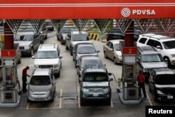 FILE - Motorists line up for fuel at a gas station of Venezuelan state-owned oil company PDVSA in Caracas, Venezuela, Sept. 21, 2017.