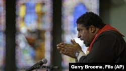 "In this Wednesday, June 24, 2015 file photo, Rev. William Barber, president of the state chapter of the NAACP and architect of the protests known as ""Moral Monday,"" speaks during a Bible study at Pullen Memorial Baptist Church in Raleigh, N.C."