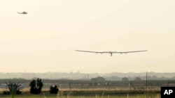 The Solar Impulse 2 plane lands at the San Pablo airport in Seville, Spain on Thursday, June 23, 2016. An experimental solar-powered airplane Thursday completed an unprecedented three-day flight across the Atlantic in the latest leg of its globe-circling voyage. (AP Photo/Laura Leon)