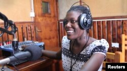 Mama FM puts women's voices and perspectives on the air, in a country where 85 percent of radio voices belong to men, Kampala, Uganda, June 18, 2014. (Hilary Heuler/VOA)