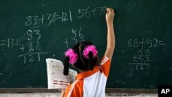 FILE - Researchers have found that poor children who tested lower on standardized tests had delays in brain development and volume.