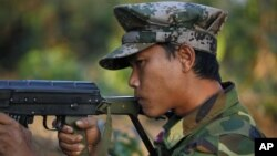 In this photo taken on Feb. 13, 2012, a Kachin soldier mans a frontline position, facing off against the Burmese government.