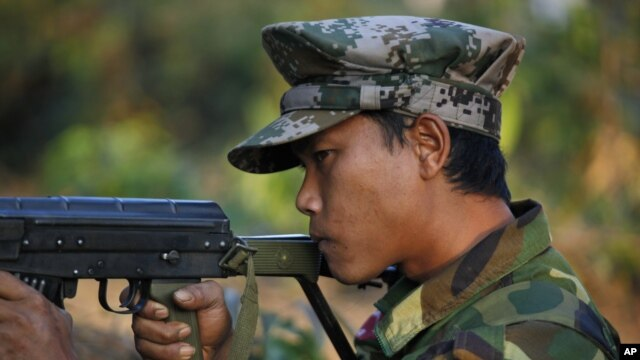 FILE - A Kachin soldier mans a frontline position, facing off against the Myanmar government.