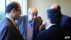 Members of the Syrian National Coalition (SNC) attend a meeting of the National Coalition on November 9, 2013, in Istanbul. (AFP File)