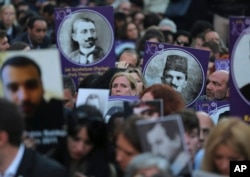 Protesters, some carrying pictures of people killed in a 1915 massacre of Armenians, hold a memorial march, in Istanbul, Turkey, April 24, 2015.