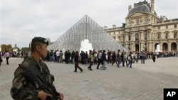 French soldiers patrol around the Louvre museum in Paris, Sunday, Oct. 3, 2010. The State Department has cautioned Americans traveling in Europe to be vigilant because of heightened concerns about a potential al-Qaida terrorist attack aimed at U.S. citize