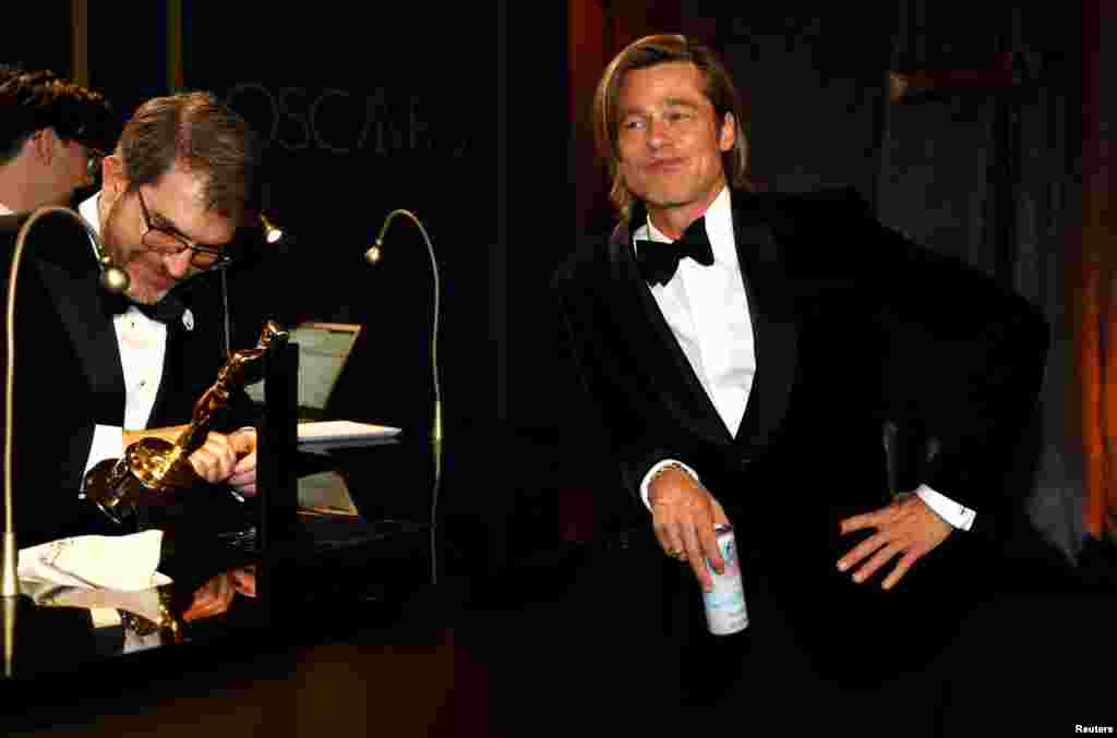 Actor Brad Pitt waits for his Oscar statue to be personalized at the Governors Ball following the 92nd Academy Awards in Los Angeles, California, Feb. 9, 2020.