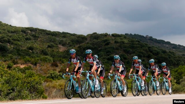 Radioshack-Leopard team riders cycle during a training session for the centenary Tour de France cycling race on the French Mediterranean island of Corsica, Porto-Vecchio, France, June 28, 2013.