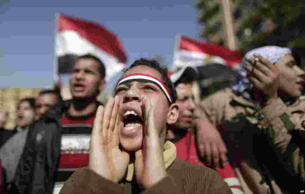 An Egyptian youth shouts slogans during a protest in Tahrir Square in Cairo, Egypt. January 26, 2012. (AP)