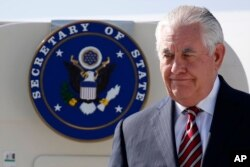 FILE - U.S. Secretary of State Rex Tillerson arrives at Djibouti–Ambouli International Airport in Djibouti, March 9, 2018.