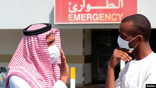 Men wear surgical masks as a precautionary measure against novel coronavirus, Dammam, Saudi Arabia, May 23, 2013.