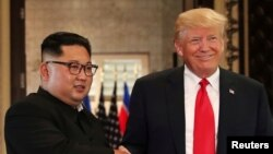 美國總統特朗普和北韓領導人2018年6月12日在新加坡會面