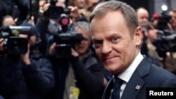 FILE - Poland's Prime Minister Donald Tusk arrives at a European Union leaders summit in Brussels, March 21, 2014.