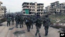 Snage sirijske vlade u jednom od gradova u pokrajini Latakija