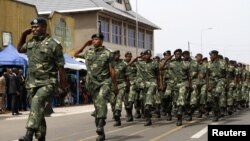 FILE - Soldiers from the Democratic Republic of Congo (DRC) take part in a parade to mark the country's Independence Day through a street in eastern city of Goma, June 30, 2014