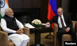 FILE - Russian President Vladimir Putin meets with Indian Prime Minister Narendra Modi in the Black Sea resort of Sochi, Russia, May 21, 2018. Modi is expected to host Putin for talks Friday.