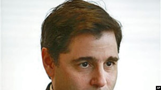 FCC Chairman Julius Genachowski is interviewed in his office in Washington, March 2010. (file photo)