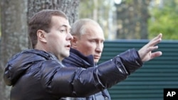 Russia's President Dmitry Medvedev (L) and Prime Minister Vladimir Putin walk at the residence in Zavidovo, in the Tver region, Russia, September 24, 2011.