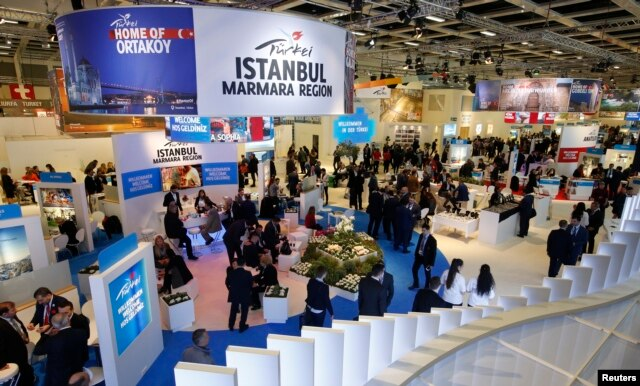 Visitors browse Turkey's stand at the International Tourism Trade Fair (ITB) in Berlin, Germany, March 9, 2016.