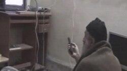 تصویری از یک ویدیو به دست آمده از مخفیگاه اسامه بن لادن در پاکستان که او را در حال تماشای تلویزیون نشان می دهد
