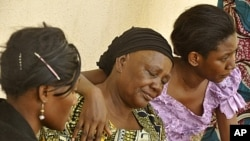 Relatives of victims of university theater gun attack in Kano, northern Nigeria, April 29, 2012.