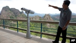 North Korea official So Myong Il introduces the rocky peaks around Mount Chilbo, North Korea.