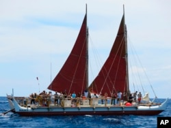 FILE - The Hokulea sailing canoe is seen off Honolulu, April 29, 2014. The Polynesian voyaging canoe is returning to Hawaii after a three-year journey around the world guided only by nature with navigators using no modern navigation across 40,000 nautical miles.