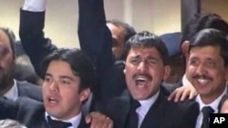 Pakistani lawyers celebrate Supreme Court decision to reopen corruption cases against President Asif Ali Zardari and some of his cabinet members
